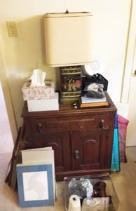 There is a lamp, side cabinet, and other items.  (You can probably just have the Kleenex though.)