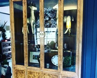 $795. Vintage Thomasville china / curio cabinet - stunning burled wood across whole piece. gorgeous brass hardware and corner accents. It does have one additional shelf not shown. They are glass and adjustable. Also one shelf in bottom cabinet. There are a couple areas of wear to the back tops of the cabinet. It may have come in contact with a ceiling during a move or something. Not noticeable but could also be fixed reasonably.