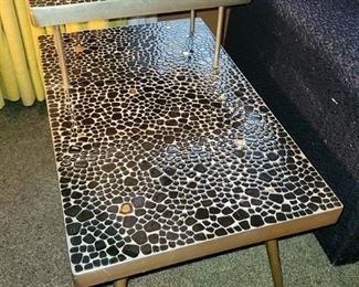 """Set of 4 Mosaic tables. Black and gold pebble tiles. Brass trim. All four pieces are in excellent condition. $950 for all (compared to $1,300 and over)  Coffee table: Kidney shaped 49"""" w x  13.5""""h 2-tier tables (quantity 2): 18""""w x 23""""h x 29.75""""d Square table: 14.5"""" x 14.5"""" x 21""""h"""