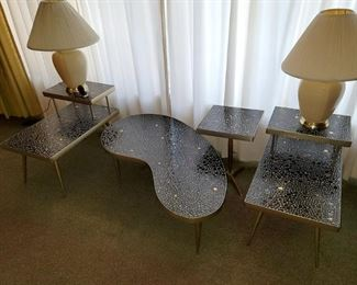 "Set of 4 Mosaic tables. Black and gold pebble tiles. Brass trim. All four pieces are in excellent condition. $950 for all (compared to $1,300 and over) Coffee table: Kidney shaped 49"" w x  13.5""h 2-tier tables (quantity 2): 18""w x 23""h x 29.75""d Square table: 14.5"" x 14.5"" x 21""h"