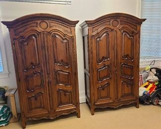 Lot 001 $6,950.00 Baker Furniture two matching Armoires. Milling Road Collection, French Rococo design, heavy molded panels with a beveled apron. Perfect addition to Farmhouse decorating. Rare to have two matching Armoires. Perfect for planning design element to your home. Circle molded design at top gives a modern flare to this traditional piece. Walnut wood. Six surfaces, five are shelves, four adjustable shelves and one fixed shelf is at 37.5 inches from the floor. Three in one options for storage. TV, hang ... Image of Baker Furniture French Milling Road Armoires - a Pair DIMENSIONS 55ʺW × 28ʺD × 90ʺH CONDITION Vintage / Antique / Used, Original Condition Unaltered, Some Imperfections Normal wear and tear for the age of the Armoires. Good condition. Minor rubbed hardware on door hinges. Wood splints on upper side of Armoires