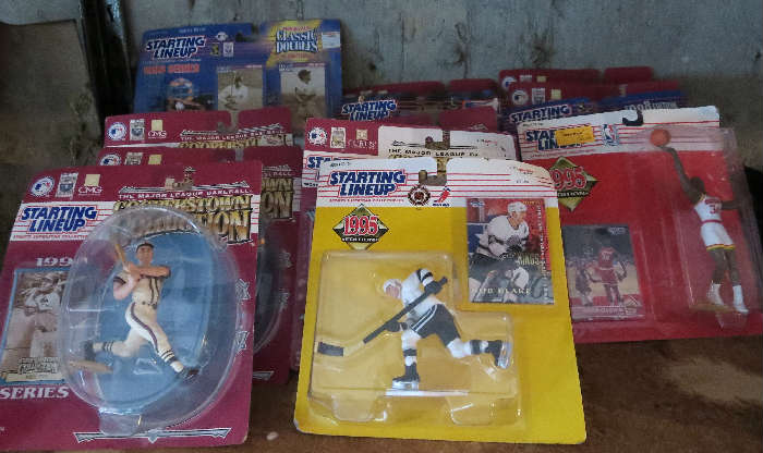 Collectable sports figurines in packages