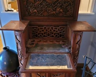 Asian carved bar opened up