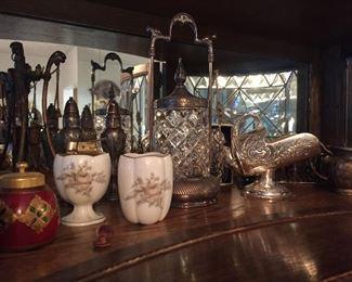 Antique silver serving pieces.