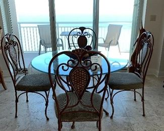 """47"""" round Glass top table and 4 chairs $300"""