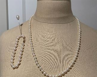 24 inch strand of cultured pearls with 14k clasp $295 7inch cultured pearl bracelet with 14k clasp  $125
