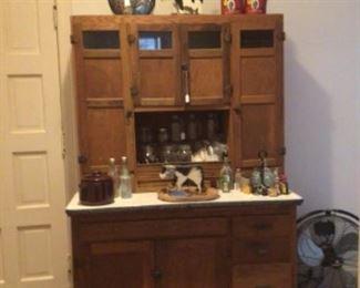 Vintage oak Hoosier cabinet, bean pot, vintage kitchen bottles, mason jars