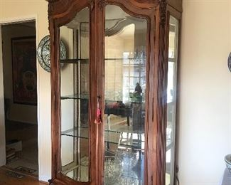 """$400  French hand-carved large curio display cabinet with glass shelves, beveled glass and interior lighting.  Height 8', Width 46"""", Depth 19"""""""