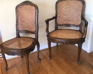 """$450 Four French cane chairs.  Two with arms and two without.  Cane on one chair needs restoration.  Height 40"""""""