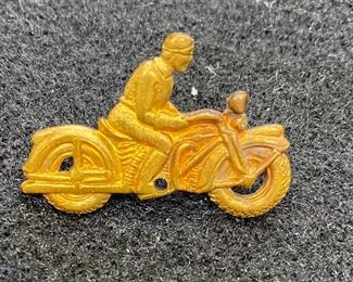 """Early Motorcycle pin. Good condition and good clasp. Believe it to be brass. Harley Davidson style motorcycle. Unmarked. Measures 1 1/4"""". $60"""