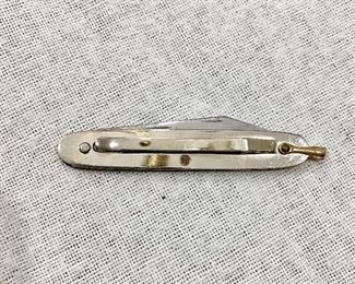 Additional photo of back side of Coca Cola knife.