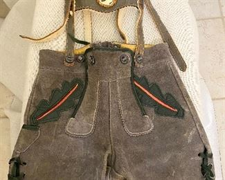 """Vintage German Child's  Lederhosen. Thick leather with carved Elk Horn medallion. All buttons & straps intack. Purchased in Germany """"1960's"""". $50"""