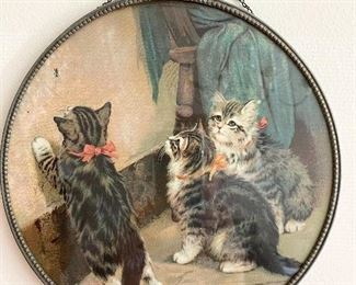 """Antique round chromo lithograph chimney flue cover features adorable little kittens looking for the fly on the wall. Chain is intact to hold the picture securely. Measures 9 1/2"""" round. Very good condition with no water stains. $50"""