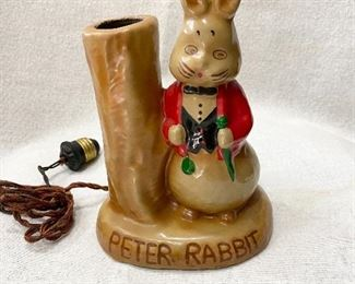 """Darling old """"Peter Rabbit"""" child's nursery lamp. Cord would need replaced. Very good condition with no chips or cracks. Not sure of the material it's made from. Not ceramic or plaster. This lamp could be from the 1920's, 30's or 40's. Measures 7 1/4"""" tall. 5 1/2"""" wide. Light weight probably less than a pound. $45"""