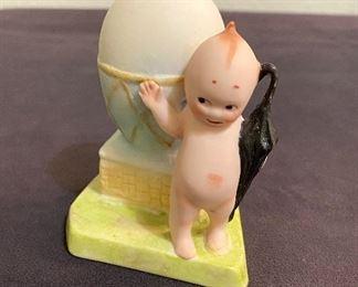 Kewpie porcelain figure with egg and umbrella. Contemporary piece. $22