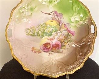 """Beautiful hand painted open handled platter marked on back with  """"Germany"""" and """"CT"""" with eagle. Measures 11"""" round. $24"""