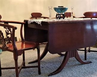 Antique table that folds down on both sides. Just beautiful! There are 4 rosewood Oriental Corner Chairs Hand Carved Back Supports.