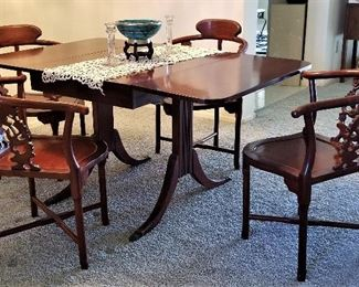 View of dining table with sides up. Antique table that folds down on both sides. Just beautiful! There are 4 rosewood Oriental Corner Chairs Hand Carved Back Supports