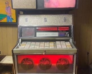 1969 Rowe Music Miracle Jukebox. 200 count musical selection. This jukebox is customizable. Jukebox has two viewing projectors. One projector plays slides  continuously & the other projector plays video slides on a Phono Vue above the unit.  This jukebox was owned & maintained by a jukebox & arcade mechanic. Many extra parts, lights & manuals for this jukebox.