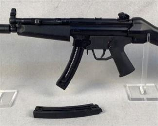 """Serial - A273446 Mfg - German Sports Guns Model - GSG-5 Caliber - 22LR Barrel - 16"""" Capacity - 10, 25 Magazines - 2 Type - Rifle, Semi Automatic Located in Chattanooga, TN Condition - 3 - Light Wear The GSG 5 is an identical replication of the MP 5, except Its a 22 cal. Because of the low cost of ammunition the GSG 5 makes a perfect plinking rifle, training rifle or a serious varmint hunting rifle. This rifle features a full 16"""" barrel underneath a faux suppressor, MP5 style charging handle, Ambi safety, and Hk style sights. This rifle comes with 1-10rd magazine and 1-25rd magazine."""