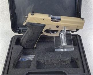 """Serial - G353541 Mfg - Sig Sauer Model - P220R Caliber - 45 Auto Barrel - 4.4"""" Capacity - 8+1 Magazines - 1 Qty - 1 Type - Pistol Located in Chattanooga, TN Condition - 3 - Light Wear This is a Sig Sauer P220R chambered in 45 Auto using authentic German made parts and assembled in Exeter, NH. These 220s also featured stamped carbon steel slide to keep the overall weight down. Current P220s use a milled slide but have added weight. This pistol was a trade-in from the Lincoln Nebraska Police Department and features 3-dot night sights and have been Cerakoted FDE. This pistol comes with 1-8Rd magazine, factory box, and manual."""