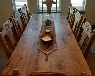 "Thursday	Friday	Saturday	Sunday $3,603	$3,153	$2,702	$2,252                      Texas Star Oak Table Set includes Table & 8 Chairs (2 Arm, 6 Side).  Chair cushions are real cowhide leather.  Table is 95"" x 40"".  Hand crafted in Mexico from solid oak wood repurposed from a barn in Florence, TX"