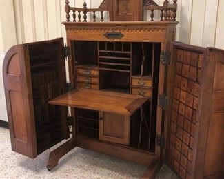 Walnut Wooten Desk with Swing Out Multi drawer files, Drop front writing Desk, Original Cast Iron Plaque Dated 1874
