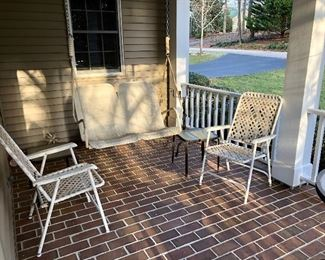 Folding chairs, porch swing and small glass top table
