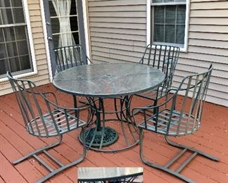 Metal glass top table with 4 chairs