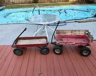 Two red wagons and round glass top table!