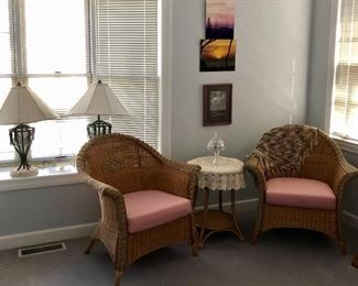 wicker chairs,  round table, two large lamps
