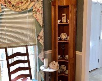 Corner cabinet full of tea cups