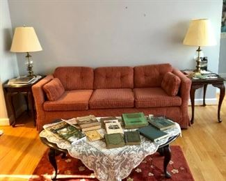Two side tables, one of 2 sofas, drop sides coffee table, lamps, vintage books and historic railroad and local book, large cherry blossom rug