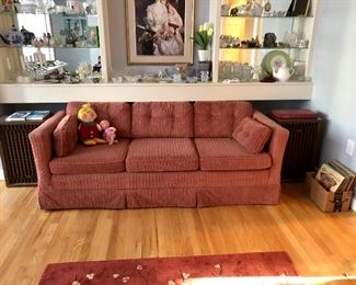 One of two sofas, Kenwood large speakers, old county albums, glass shelves full of smalls, Dapper Dan Doll
