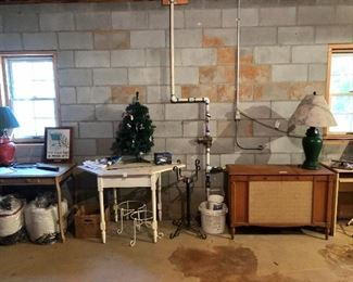 Nice small painted tables, metal pot holders, mini Christmas tree, stereo cabinet, lamps...