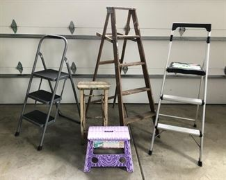 Assorted folding ladders and step stools. The two metal ladders have sold
