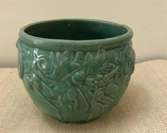 "Ceramic pot measures 7"" tall with 7"" diameter opening"