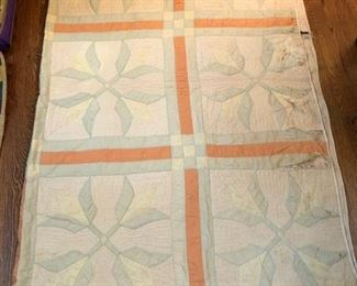"Antique quilt.  There are some holes on one side, which are pictured 80"" x 72"".  This is a great ""cutter quilt"""