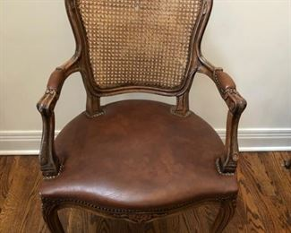 Antique cane and leather armchair