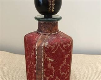 Tapestry and leather clad decanter