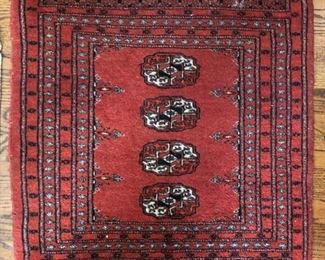 "Small Persian rug measures 29"" L x 26"" W"