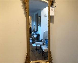 "Gold LaBarge entry mirror with shelf. Measures 58"" W x 18"" W x 7"" D"