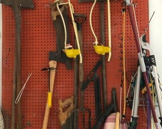 Garden tools including spade, ax, saws, loppers, shovels and lawn sprinklers
