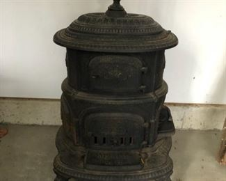 "Antique cast iron parlor stove, circa 1880s - 1890s. Manufactured W.M. Resor & Company (Cincinnati, OH). Measures 38"" H x 20"" D x 24"" W. Picture 1 of 2"