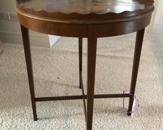 "Antique scallop edge side table. Measures 25"" H with a 21"" diameter. Top needs refinishing or paint for a more modern feel"