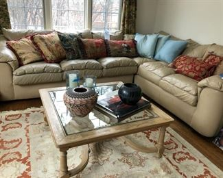 "Coffee table, Leathercraft sectional sofa measures 93"" x 115,"" assorted pillows, 6' x 9' Peshawar wool Persian rug"