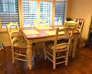 Legacy Classic kitchen table with six chairs. Four chairs shown. Extension extends seating to 6