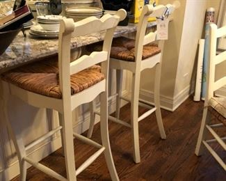 Two Legacy Classic cane-seat bar stools