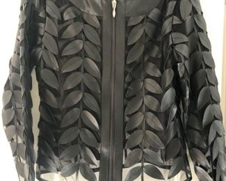 Colleen Lopez cutout faux leather jacket. Runs large. One of our favorites from more than 100 pieces of designer clothing and coats in sizes S, M & L and Size 2 - 10