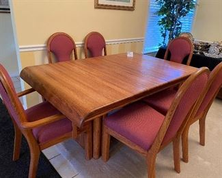 Incredible wooden table--GROOVY--with 4 side chairs and 2 arm chairs